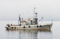 Small ship in the Bay of Nogaeva . Okhotsk Sea