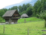 Old swiss house in mountain landscape