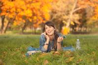 Women enjoy in a autumn park.