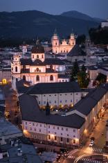 Kollegienkirche and Salzburg Cathedral at night in Austria