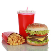 Double Cheeseburger meal with french fries and cola, isolated
