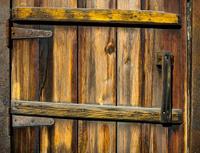 Old rusty weathered window with door