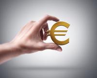 hand holding Golden Euro simbol