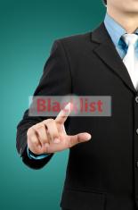 businessman hand touching blacklist  button