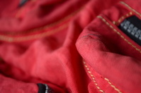 vivid red fabric with  Nylon plastic zippers