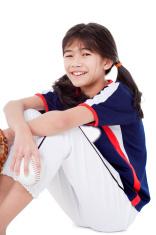 Little league softball player holding ball