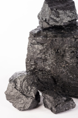 heap of thermal coal on white background portrait