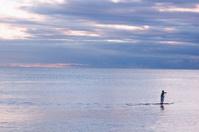 Paddle Boarder and a Calm Sea