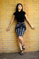 Attractive Asian American Woman Stylish Skirt Standing