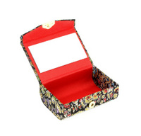 open small box with mirror inside