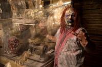 Serial Killer Clown hold victim in his cabin