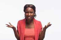 Woman reacting negatively to news, horizontal