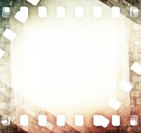 vintage light scratched film strip background
