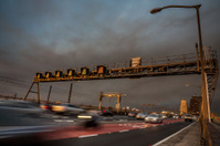 Traffic on Sydney Harbour Bridge, dramatic sky