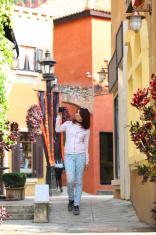 Urban modern woman outdoor walking in city street.
