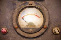 Vintage dusty volt meter in a metal casing