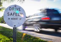 Drive Safe memorial roadside sign.
