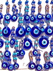 Blue glass evil eye charms