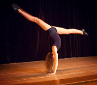Young Girl at School Dance Recital Doing a Walkover.