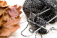 Knitting needle with wool and foliage