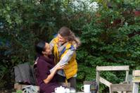 Friends Meeting for Tea In Urban City Garden, London