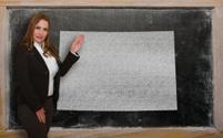 Teacher showing map of colorado on blackboard