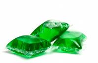 Three green laundry detergent capsules