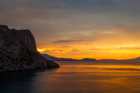 golden sunset on the sea and mountain view
