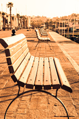 bench on promenade at sunrise