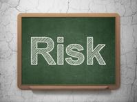 Business concept: Risk on chalkboard background