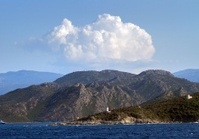 Mountainous background of Saint Florent, Corsica with cumulus cl