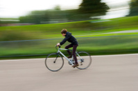 Boy riding a bike in park