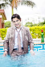 Excited Indian Businessman inside the Swimming Pool splashing wa