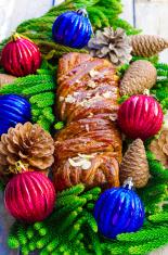 Christmas log with cinnamon and almonds