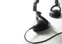 black headphone with cord.
