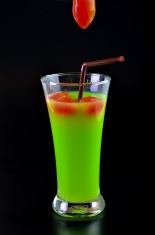 Guava shake drink in glass and tomato