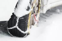 Snow Chains on a Car Tire