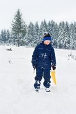 Boy staying in snow