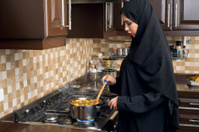 Arabian Woman cooking food in her kitchen