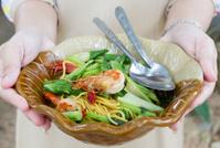 Woman is serving noodles