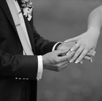 Hands of wedding couple.