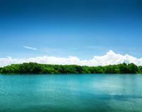 Silent lake under blue sky