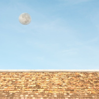 old rooftop and moon