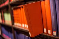 plain book jut out a bookshelf