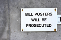 Bill posters warning sign shops close as trade declines