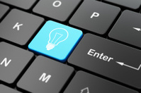 Business concept: Light Bulb on computer keyboard background