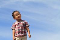 Smiling Japanese boy under the blue sky