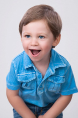 boy smiling in blue shirt