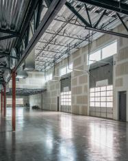 Empty warehouse, neutral tone, new construction