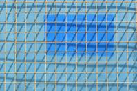metal grid against a blue background